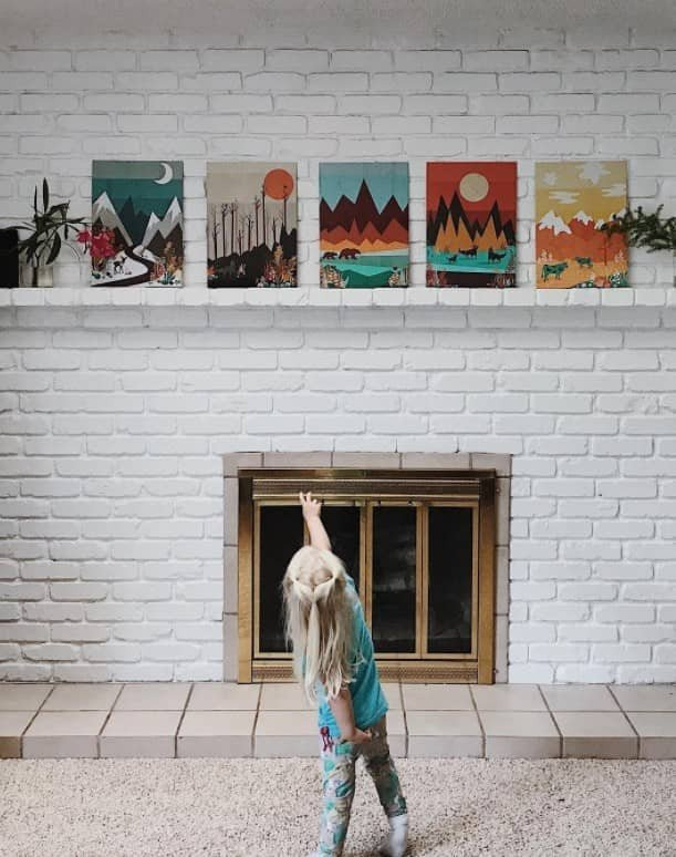 hanging art over fireplace