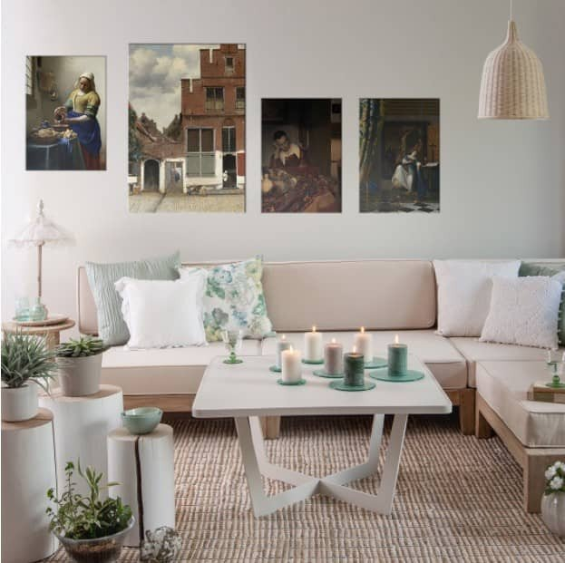 fine art arrangement of 4 pictures on a wall