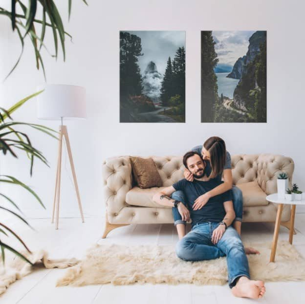 side by side picture arrangement over a sofa