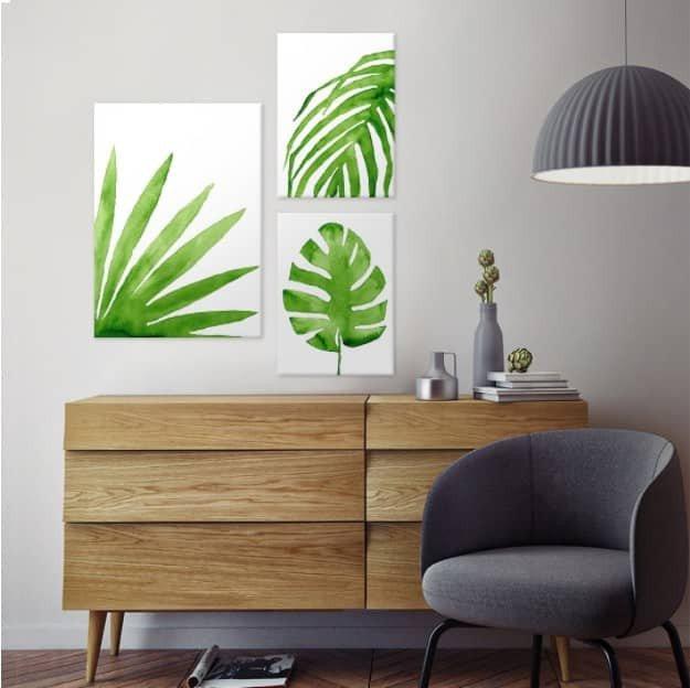 3 piece botanical prints arranged on a wall