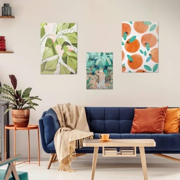 Arranging art over sofa