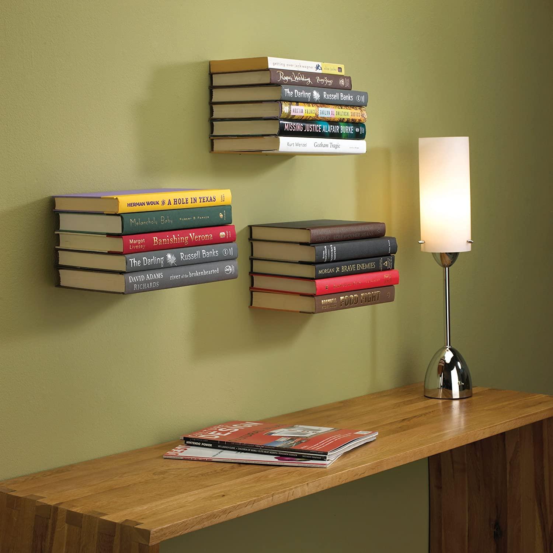 Stacks of books on floating shelves