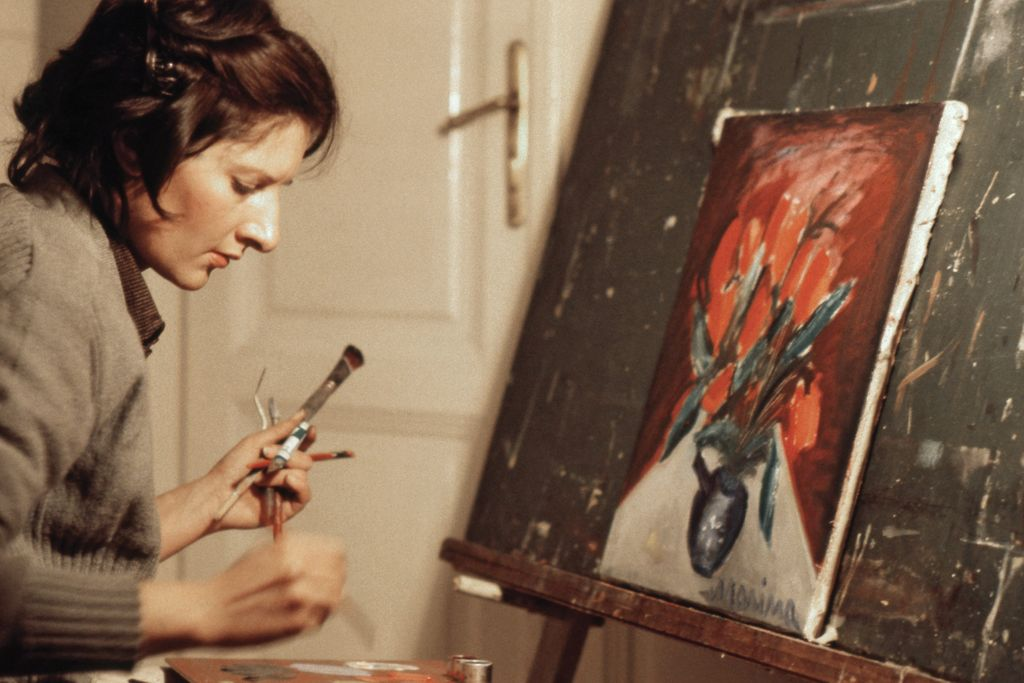 Marina Abramovic painting in front of an easel